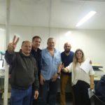 Guacone, junto a Berni e integrantes de su lista.